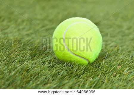 Tennis Ball On Green Pitch