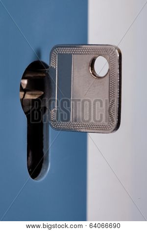 Silver Key In The Keyhole Of Door