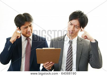 Frustrated Asian businessmen