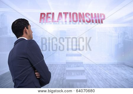 The word relationship and unsmiling asian businessman with arms crossed against city scene in a room