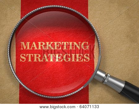 Marketing Strategies. Magnifying Glass on Old Paper.