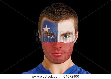 Composite image of serious young chile fan with facepaint against black