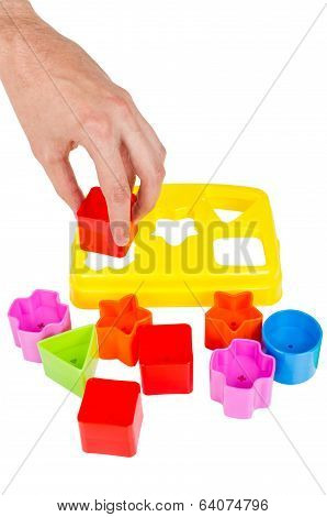 Human Hand Puts Wrong Shape Into Shape Sorter Toy Isolated