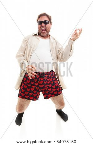 Funny photo of a middle aged man playing air guitar in his underwear.  Full body isolated on white.