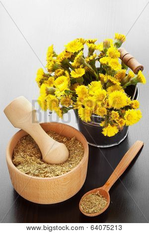 Mortar On Table And Bucket With Coltsfoot Flowers, Herbal Medicine