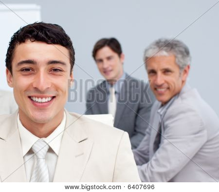 Portrait Of A Smiling Businessman In A Meeting