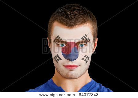 Composite image of serious young korea republic fan with facepaint against black