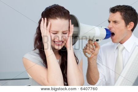 Businessman Shouting Through A Megaphone At His Colleague