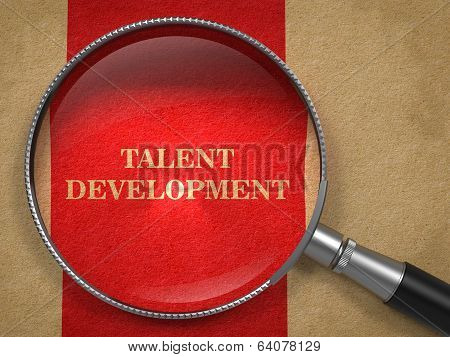 Talent Development. Magnifying Glass on Old Paper.