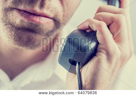 Man Listening To A Telephone Conversation