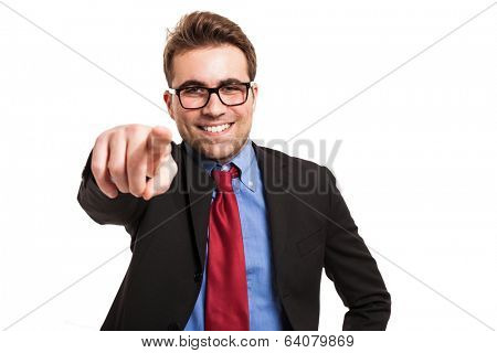 Friendly businessman pointing his finger at you. Isolated on white