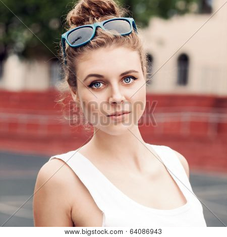 Beautiful Lady In White T-shirt With To-go Cup At Sport Court