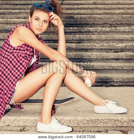 Beautiful Lady In Jeans Shorts With Skateboard And To-go Cup At Stone Stairs
