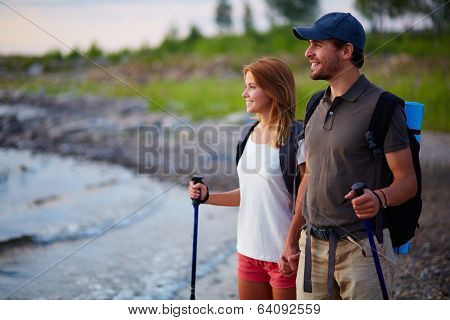 Portrait of couple of happy hikers on a trip