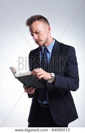 young business man reading an interesting book. on a light studio background