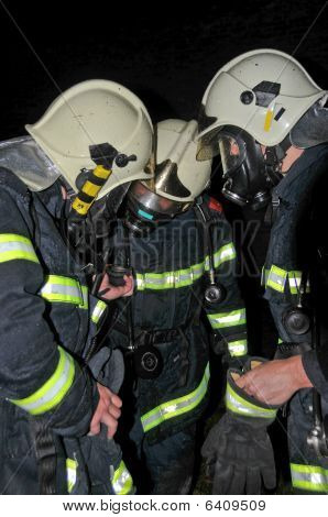 Firemen In Respirators