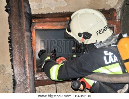 Fireman Extinguishes Fire