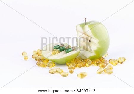 SLICED GREEN APPLE WITH CAPSULES