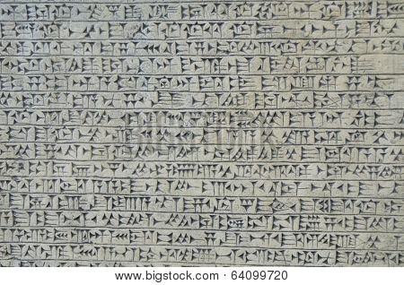 Background image of cuneiform script