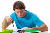 picture of tasks  - Male student working on task on isolated background - JPG