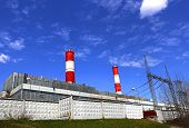 image of chp  - High factory chimney over blue sky background - JPG