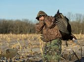 stock photo of gobbler  - A young hunter with a large Wild Turkey - JPG