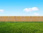foto of wooden fence  - wooden garden fence on a green grass - JPG