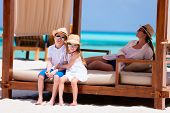 pic of cabana  - Happy beautiful family relaxing at beach during summer vacation - JPG