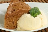 stock photo of toffee  - Slice of toffee fudge cake with vanilla ice cream - JPG