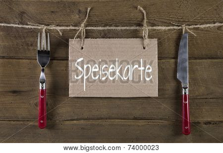 Menu card in old rustic country style with german text and knife and fork.