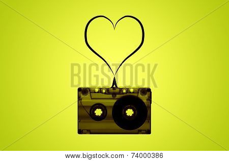 A cassette tape with a heart made of tape coming out of it.