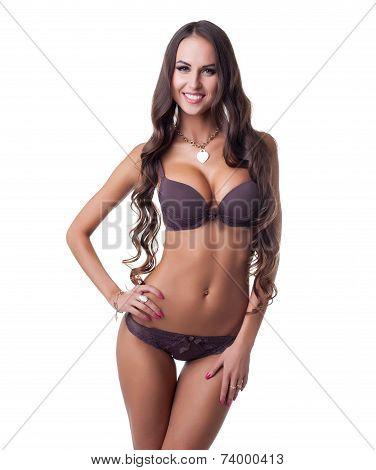 Happy tanned girl posing in erotic underwear