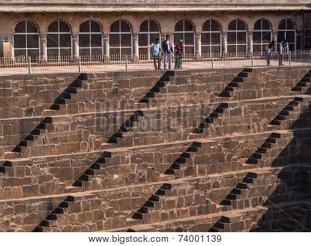 Tourists At The Famous Chand Baori Stepwell In Abhaneri, Rajasthan, India
