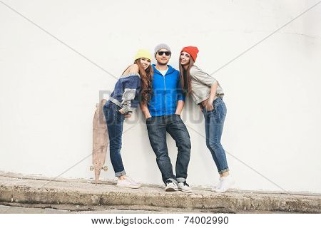Two Young  Hipster Girl Friends And Guy
