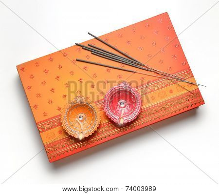 A box of sweet with sparklers sticks and traditional oil lamp