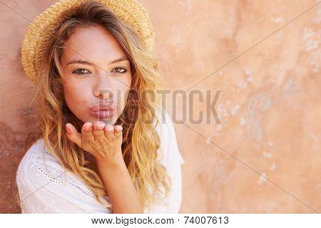 Pretty Young Woman Blowing Kiss Towards Camera