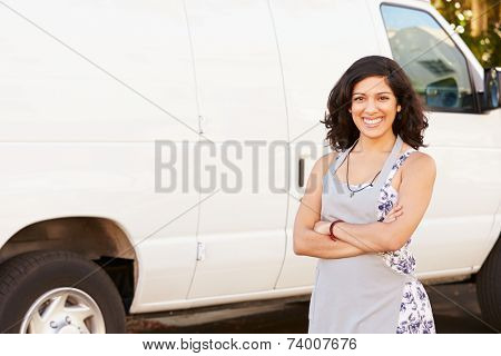 Woman Wearing Apron Standing In Front Of Van