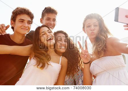 Group Of Teenage Friends Dancing And Taking Selfie