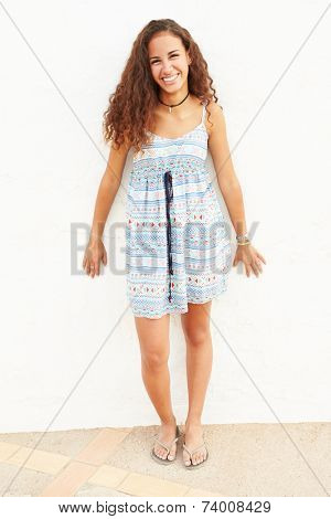 Portrait Of Teenage Girl Leaning Against Wall