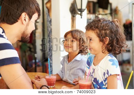 Children Drinking Fruit Smoothies In Restaurant