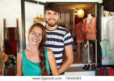 Portrait Of Couple Running Clothing Shop Together
