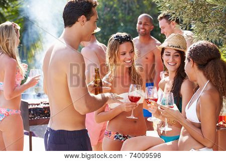 Group Of Friends Having Party By Swimming Pool