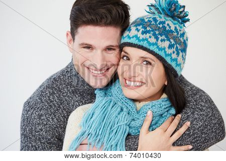 Studio Portrait Of Couple Wearing Warm Winter Clothes