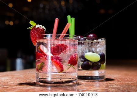 Two Glasses Of Strawberry And Grape Mojitoes