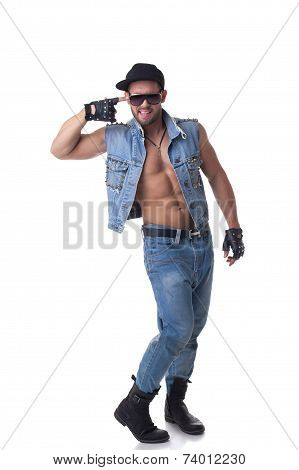 Cheerful muscular male model posing in denim suit