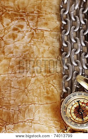 Compass And  Chain On Vintage Old Paper Background