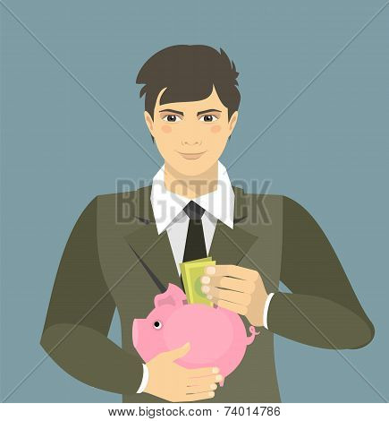 Man Lays Down The Money In A Piggy Bank