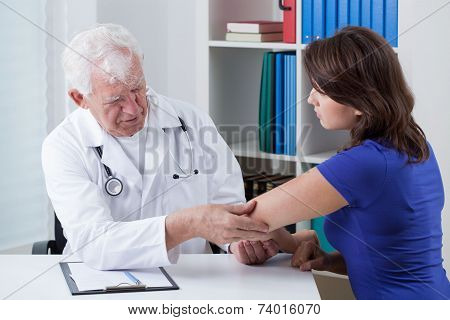 Orthopaedist Diagnosing Painful Elbow