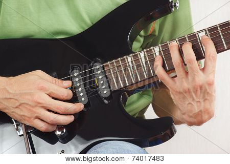 Hands of guitarist put guitar chords close up