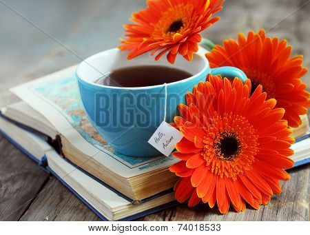 A Cup Of Tea With Gerbera Flowers And Books